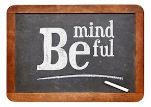 Be mindful sign - motto or resolution on a vintage slate blackboard