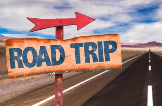 bigstock-road-trip-sign-with-road-backg-87933701